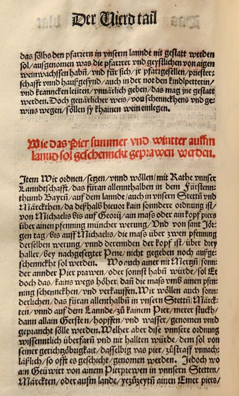 The first page of the original certificate of the Reinheitsgebot from 1516. Black and red letters in an old font on a yellowed parchment.