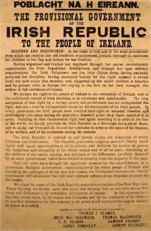 Photo of an original copy of the 1916 Proclamation. Black letters on a yellowed, ochre-coloured paper.